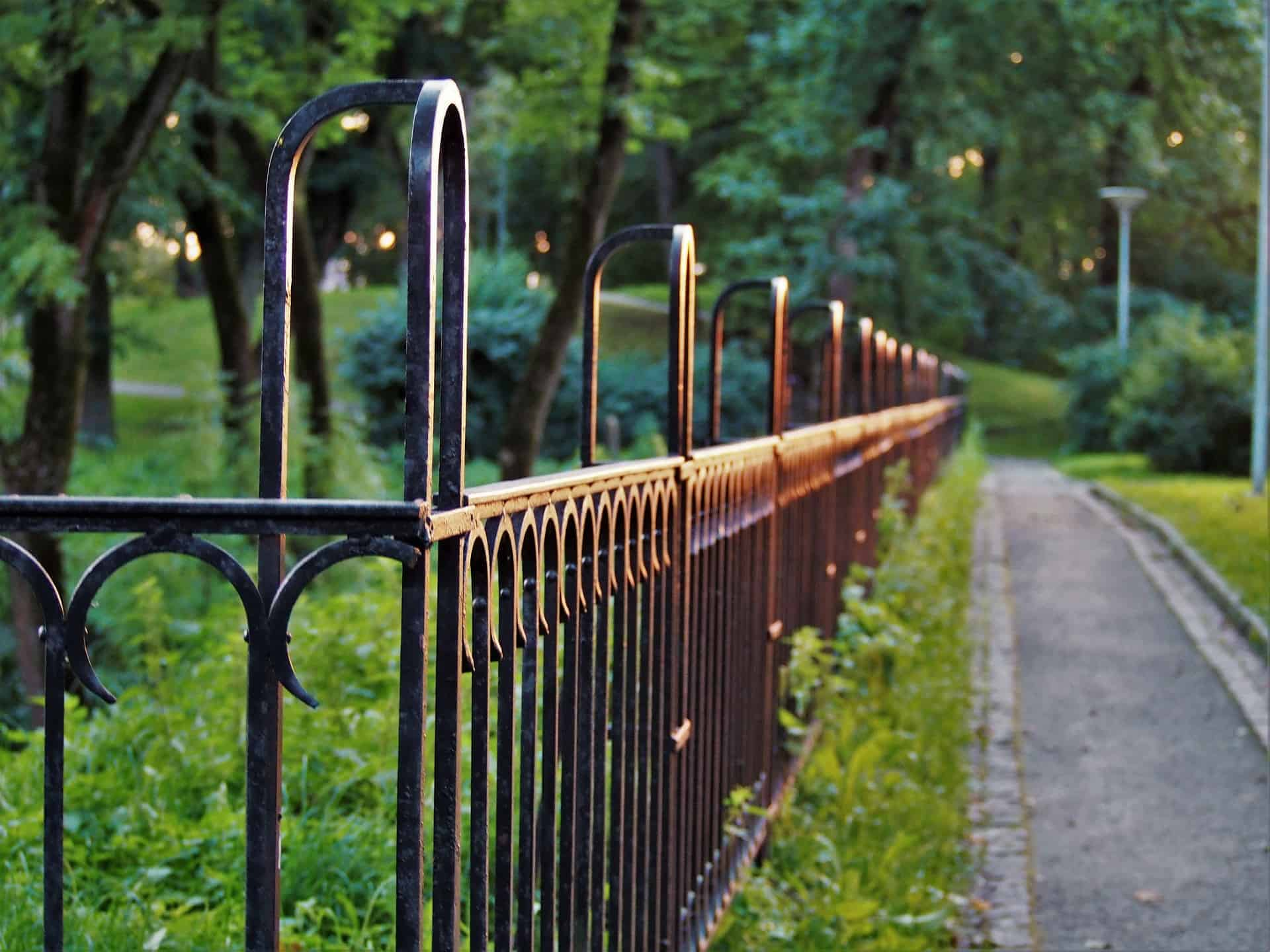 canva black metal fence
